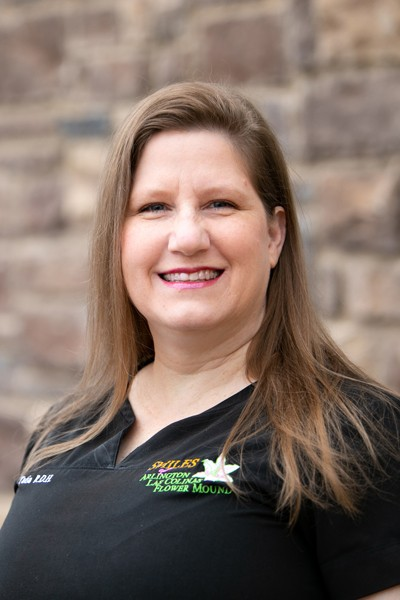 Blonde Female team member for Smiles Family dental in Flower Mound, TX